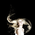 Hair care young attractive blond woman with in splashes Royalty Free Stock Photo