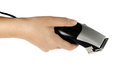 Hair clipper in hand on white background Royalty Free Stock Images