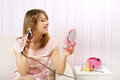 Hair curling girl in a dress on light background Stock Images