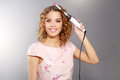 Hair curling young girl with curly Royalty Free Stock Photography