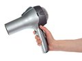 The hair dryer in a hand isolated on white Stock Photography