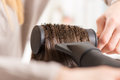 Hair drying long brown with dryer and round brush close up Royalty Free Stock Image