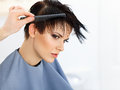 Hair. Hairdresser doing Hairstyle. Beauty Model Woman. Haircut. Royalty Free Stock Photo