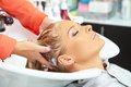 Hair salon. Washing with shampoo. Royalty Free Stock Photo
