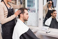 Hair stylist drying mans hair at the salon Royalty Free Stock Images