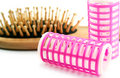 Hairbrush and hair-rollers Royalty Free Stock Photo