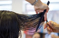 Haircut woman getting at hairdresser salon Stock Images