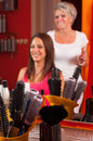 Hairdresser and beautiful girl having fun Stock Image