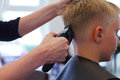 At the hairdresser a boy gets a new hair cut Royalty Free Stock Photo