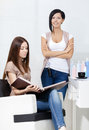 Hairdresser and the client in hairdressing salon concept of fashion beauty Royalty Free Stock Image