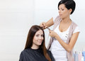Hairdresser cuts hair of woman in hairdresser s women concept fashion and beauty Royalty Free Stock Photos