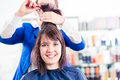 Hairdresser cutting woman hair in shop Royalty Free Stock Photo