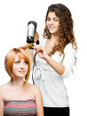 Hairdresser with hair dryer Stock Photo