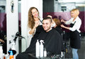 Hairdresser making haircut in hair studio Royalty Free Stock Photo