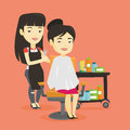 Hairdresser making haircut to young woman.