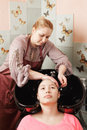Hairdresser work washing head teenage girl Stock Photography