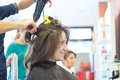 Hairdressing woman dries hair at salon Royalty Free Stock Photo