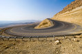 Hairpin bend in desert a on a road the mountains of the negev israel Stock Photos