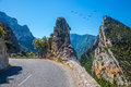 The hairpin bend on a mountain road picturesque and dangerous migrating cranes over largest alpine canyon verdon Royalty Free Stock Photo