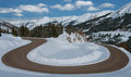 Hairpin turn a twisting road loops and switches back through a snowy pass in the rocky mountains of western colorado Royalty Free Stock Image