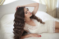 Hairstyle. Beautiful brunette bride girl with long healthy wavy Royalty Free Stock Photo