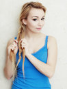 Hairstyle blond woman teenage girl plaiting braid hair portrait of indoor Royalty Free Stock Photos