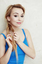 Hairstyle blond woman teenage girl plaiting braid hair portrait of indoor Royalty Free Stock Photo