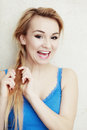Hairstyle blond woman teenage girl plaiting braid hair portrait of indoor Royalty Free Stock Photography