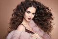 Hairstyle. Curly hair. Fashion brunette girl with long curly hai Royalty Free Stock Photo