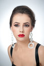 Hairstyle and make up beautiful female art portrait with earrings elegance genuine natural brunette with jewelry jewelries in Royalty Free Stock Photography