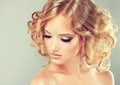 Hairstyle medium length pretty blonde girl with curled hair hair styling Stock Photo