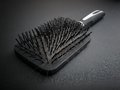 Hairy hairbrush full of fallen hairs during hairstyling Royalty Free Stock Photo