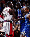 Hakeem olajuwon shaquille o neal houston rockets center oljawon faces off against a young of the orlando magic image taken from Royalty Free Stock Images