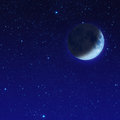 Half blue moon with star at the night sky mystery dark Royalty Free Stock Photo