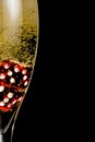 Half champagne flute with gold fine bubbles and red dice Royalty Free Stock Photos