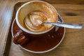Half a coffee latte art in shop Stock Photos