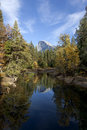 Half dome from sentinel bridge fall view of merced river reflection of yosemite valley Royalty Free Stock Photography