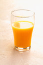 Half drunk glass of fresh orange juice Stock Photo