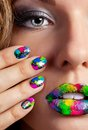 Half face of attractive girl with beautiful multicolor holographic minx nails and bright colorful make up Royalty Free Stock Photos
