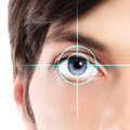 Half face Closeup of blue eye from a young man and laser hologram on her eye Royalty Free Stock Photo