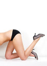 Half female body showing legs and shoes Royalty Free Stock Photo