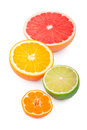 Half fresh citrus fruits white background Royalty Free Stock Image