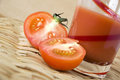 Half fresh tomato put glass tomato juice Royalty Free Stock Photos