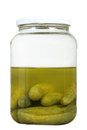 Half full pickle jar on a white background Royalty Free Stock Images