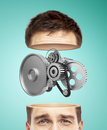 Half head and metal gears on a green background Stock Image