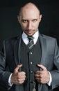 Half-length portrait of bald businessman wearing business suit Royalty Free Stock Photo