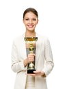 Half length portrait of business woman with golden cup keeping gold isolated on white concept victory and success Royalty Free Stock Photo