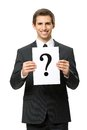 Half length portrait of businessman with question mark handing isolated on white concept problem and solution Stock Photos