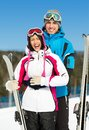 Half length portrait of embracing alps skiers Stockfotografie