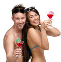 Half length portrait of half naked couple with cocktails isolated on white concept romantic vacations and lovely honeymoon Stock Photography